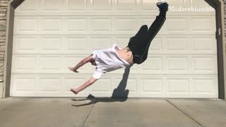 Guy does a backflip in front of his garage and falls
