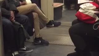 Lady dances by herself in a subway train