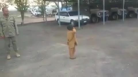 Trained small boy showing parade in front of army