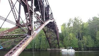 Leaping Off A Train Bridge Into The River, Includes Back Flip Fail! | Jason Asselin  - Video