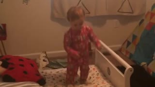 Baby Shuts Down And Falls Off Bed - Video