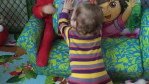 Twin baby girls play together - Video