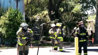 Florida firefighters battle burning building during red flag day