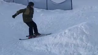 Guy tries doing front flip and falls on snow - Video