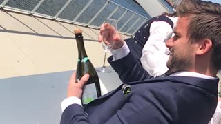 Guy tries to open champagne bottle with glass sabrage