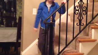Kid Walks Around House Singing With A Diaper On His Head - Video