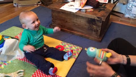 Baby finds game of catch absolutely hysterical