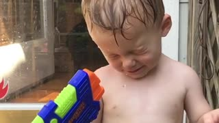 Collab copyright protection - kid shoots water gun into eye - Video