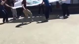 Kid jumps into sheet held by other kids - Video