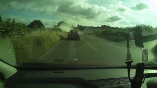 Intense truck collision captured on dash cam - Video