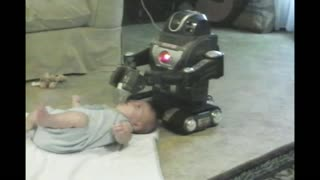 Older Brother Uses Robot Toy To Bottle Feed Baby Brother - Video