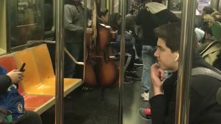 Latin band plays with bass in subway - Video