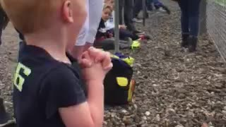 Boy Shakes With Excitement At Seeing Motorbikes Race For The First Time - Video