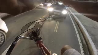 Cyclist Stops a Car from Crossing Over Bike Path - Video