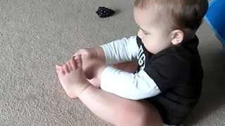 Frustrated Baby Can't Put His Sock On - Video