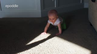 Confused Baby Is Startled By The Lurking Shadow On The Floor - Video