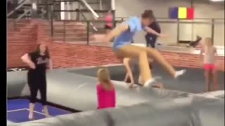 Man in light blue jumps and drops little girl - Video