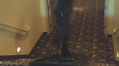 Man in black down stairs on black up side down table