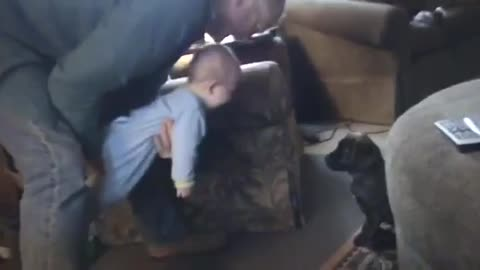 Baby laughs hysterically at rambunctious puppy