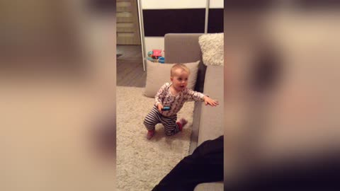 ADORABLE BABY Pretends Talking to Grandma on iPhone