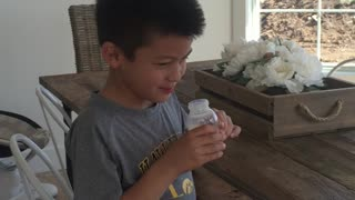 Older siblings taste mom's breast milk  - Video