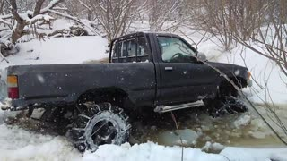 Toyota Hilux Pickup in the snowy swamp - Video