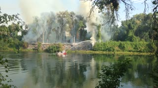 Fire Boat Puts Out Fire On The American River - Video