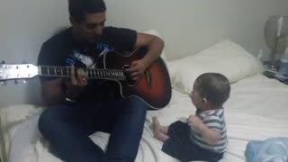 Baby laughs hysterically at guitar performance