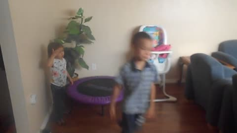 boy demonstrates comically how to use an exercise ball