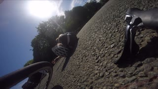 Cyclist hit in roundabout by driver failing to signal - Video