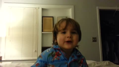 2 year old sings santa clause is coming to town Super cute