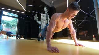 Strong muscular guy workout his chest