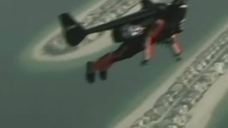 Jetpack wearing men soar over Dubai - Video