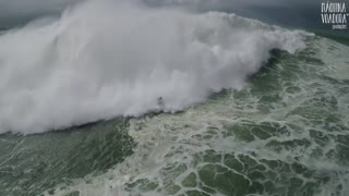 Drone Captures Giant Wave Surfing And Dramatic Rescue - Video