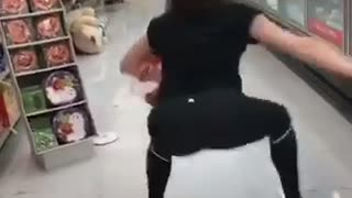 Girl in black tights at store dances and falls down