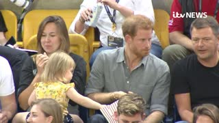 Prince Harry Reacts to a Little Girl Stealing His Popcorn - Video