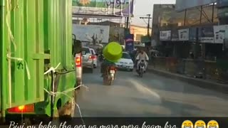 Pakistani man ride motorcycle with giant tub