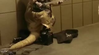 Trex subway playing guitar