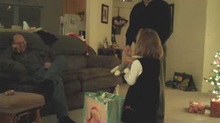 Young girl gets a sock monkey for christmas