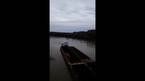 Large Tugboat Almost Loses Control Around River Bend