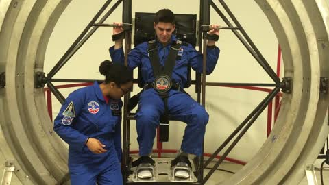 Getting spun around in a multi-axis trainer at NASA space camp
