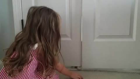 3-year-old plays adorably fun game with her kitten
