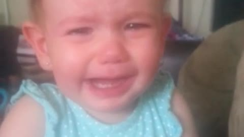 Emotional baby bursts into tears at mom's singing