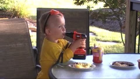 Baby Handyman Licks Frosting Off Moving Powerdrill