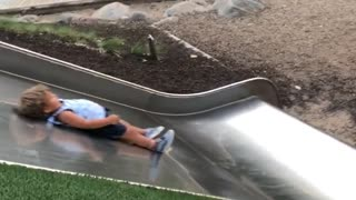 Three people down metal slide boy slow