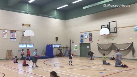 Man in grey throws dodgeball at kid in red
