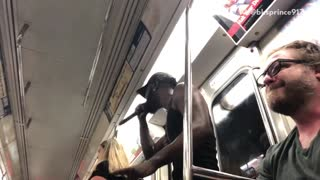 Guy singing over cardi b on subway train - Video