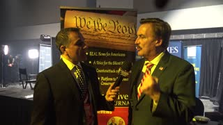 Mike Lindell at the Turning Point USA with John Di Lemme