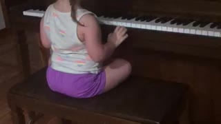 Little Girl playing on the Piano funny
