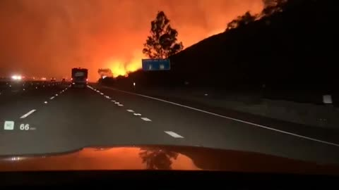 Helicopter Drops Water on Intense Fire
